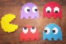 8-bit Bead Pixel Art / Colorful plastic beads from Perler, Hama, etc. With a bit of imagination, you can create with them a bunch of beautiful things to decorate what you want! Here are some good examples I like :-)