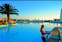 Crete - Aldemar Knossos Royal / Aldemar Knossos Royal Beach Hotel is bathed in sunlight, calmed by the gentle waves of the Aegean Sea  and within easy reach of a spectacular beach. Family-friendly hotel.