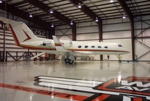 Planes Trains and Automobiles! / Stonhard seamless flooring in aerospace, transportation, and automobile facilities.
