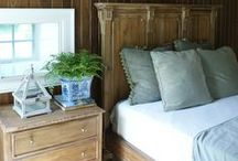 A Place For Returning / The original Honey House became part of the new addition and while we loved the beams and deep set windows, we added walnut paneling to both tie in with the rustic beams and anchor the vaulted ceilings above the bed. The effect is rich, historical and cozy.
