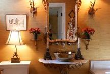 Solitary Pursuits / The Parisian style bathroom neither bores you nor overwhelms you but suggests a quiet haven. The cast iron soaking tub under a graceful arch and the vessel sink atop an antique Italian wall bracket lend a mellow tenor to the end of the day.