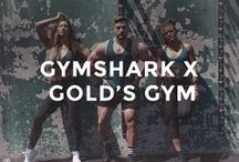 GYMSHARK X GOLD'S GYM / The ultimate union - Gymshark X Golds Gym is an exclusive limited-edition collaboration. The collection channels the Gold's Gym aesthetic, combining Gymshark's innovative design and essential styles - with that classic tapered fit. Complete with a contemporary colour palette and tonal logos, each piece is designed to enhance and accentuate specific areas of the body.