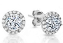 Halo Diamond Earrings / The halo style always brings some extra glamor to any fabulous diamond, including King of Jewelry's stud and dangling earring collections.