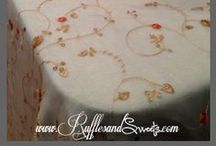 Autumn Flowers - Couture Linen / This embroidered overlay, has beautiful detailed flowers in gold, and orange. It is perfect for a bridal shower, baby shower, birthday, or other celebration. Made in the USA. For sale or rent (locally). Fits a 6′ rectangular table, can be made to order for other sizes, must inquire for pricing. #couturelinen #autumn #autumnbirthday #embroidered #birthday #bridalshower #babyshower #quince #sweetsixteen