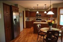 """Award Winning Kitchen Remodel - 2015 NARI REMY Gold Medal / FROM COUNTRY TO COLOSSAL CabinetReface Kitchens & Bathrooms provided the client with the kitchen of their dreams by… •Giving the client a """"high end $50,000 designer kitchen"""" within a $25,000 budget  •Changing cabinetry from """"golden oak"""" to cherry •Opening up the kitchen by removing the wall •Increasing convenience •Installing granite counter top and new tile back splash •Adding a glassware cabinet •Removing the outdated wallpaper and painting the walls •Adding lighting"""
