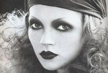 Roaring Twenties / Actual 20s make-up and 20s inspired looks. Straight eyebrows, black rounded, sad looking eyes, small dark lips.