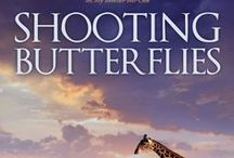 Book: Shooting Butterflies - Published Date: December 2014 / Set in Africa - as usual. Exploring the old stigma of pregnancy before marriage, mothers who smother sons, feisty female characters who have backbones of steel and are not afraid of the world, and love that lasts forever, in a politically charged time...I love this book - and I can only hope the readers will too.