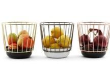 CANASTA - ENAMEL WIRE BASKET / Add some style to your table and your home with Canasta, a series of enamel basket containers, black and white, enriched by a wire cage, in different metal finishes. Enamel is traditionally used for its durability, chemical-resistance and glossy finish. It is perfect as a table container for fruit or other food but it becomes iconic when hung on the wall.