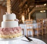 Our Threshing Barn / The 200-year-old Threshing Barn radiates rustic charm with its authentic wooden beams and iron wrought chandeliers. This combined with stylish contemporary touches, such as the unique concrete polished floor make the barn an ideal Sussex venue for any wedding party.