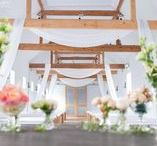 Our Dairy Barn / The simple but romantic Dairy Barn is fully licensed for all civil ceremonies and partnerships. With a wonderful sweeping 22 metre aisle, exposed wooden beams and benches made of sweet chestnut, the wedding barn is an idyllic setting for loved ones to exchange their vows.