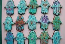 Hamsa חמסה / The Hamsa, also known as the Humes hand, the Hand of Fatima and the Hand of Miriam is a popular symbol found throughout the Middle East and northern Africa, particularly within the Islamic and Jewish faiths. It is one of the national symbols of Algeria and appears in its emblem.  The Hamsa symbolise protection from evil and envy.