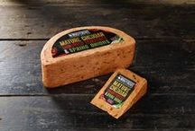 Sundried Tomato & Spring Onion Cheese by Windyridge Cheese Ltd / Sweet sundried tomatoes and fresh spring onions blended with the finest mature Cheddar make this product a household favourite. Kids love it too, with its similarities to a margarita pizza, or even melted on toast.  by WIndyridge Cheese Ltd