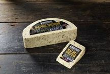 Cracked Black Pepper & Garlic Cheese by Windyridge Cheese Ltd / A smooth garlic aroma combined with a kick of black pepper then blended with the finest mature Cheddar. Perfect to eat on its own or fantastic melted as part of a cheese sauce for pasta, it's both delicious and versatile by WIndyridge Cheese Ltd
