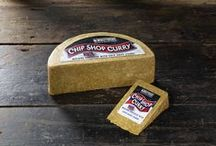 Chip Shop Curry™ Cheese by Windyridge Cheese Ltd / We love nothing more than some curry sauce from the chippy, and that was the very inspiration for our mature Cheddar with Chip Shop Curry sauce. Grate some over your chips for the best cheesy chips you'll ever taste! by WIndyridge Cheese Ltd