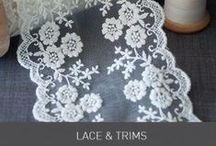 Lace / Our delicate and detailed lace gives a really beautiful and elegant finish to wedding stationery and invitations. coupled with pretty papers, embellishments and self adhesive crystal and pearls really enhances details in the lace. Find inspiration at www.imaginediy.co.uk