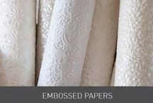 Embossed Papers / Our wide variety of embossed papers range from regal patterns to floral and sequin textures and come in a variety of colours. Adding that depth to your wedding invitations, seating plans and stationery, you can create a luxury wedding effect when paired with ribbons and embellishments. www.imaginediy.co.uk