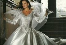 Bridal Gowns...1980's / The Queen Anne and high necklines, key hole backs, leg o'mutton sleeves, long trains, ruffles, forehead headpieces and veils with a pouf...it was a great decade for bridal!