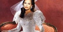 Bridal Gowns of the 1990's / The 1990's bride wanted cutwork lace, a basque waist, sleeves, beadwork and a cathedral train. This was the decade of wedding decadence, and we love it!