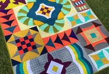 Curve It Up / Curve It UP is our sampler quilt. It can be used as a block of the month. 12 traditional blocks turned modern with a curve.