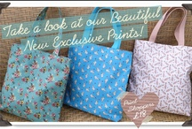 Sping/Summer 13 Ollie&Nic Old&New Print Archive / Durable and colourful oilcloth shoppers , holdalls and rucksacks plus cosmetic bags, gadget cases and card holders in a variety of exclusive prints make up the Ollie&Nic print archive collection. Distinctive florals are recoloured and fun new 'conversation' prints in Ollie&Nic's unique vintage style are introduced each season.