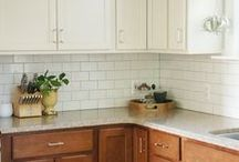 "White & Honey Maple Kitchen / Inspiration for my mom's $200 kitchen makeover.  White upper cabinets, Honey Maple base cabinets, brick bond 4x4"" white and gray tile, accents in mellow yellow, earthy red, side ""pantry"" in market style."