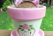 Gift Basket Flowerpots / Yes, you can use a flowerpot to make a wonderful gift basket.  Just fill them with all kinds of goodies and you get a flowerpot to plant in also.  Super Gift Idea!