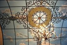Sky Ceiling Mural by Tom Taylor of Wow Effects, painted in a great room in a Virginia home. / Sky Ceiling mural complete with sky, clouds, ironwork, mosaics, and doves.