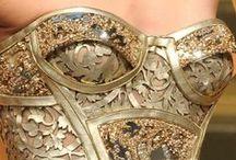 Woman in gold, silver, metalic