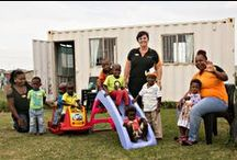 Ducats North Early Learning Playgroup / About Ducats North: This informal settlement in East London is home to thousands of children, many of whom are raised in single parent households. Alcohol and drug abuse is rife in this community with no safe places for children to play.