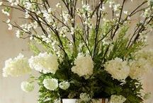 Centerpieces / Enjoy being creative with Flowers and unique containers and objects. We sure do!