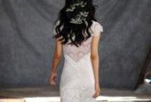Claire Pettibone / Claire Pettibone Romantique collection includes a mixture of flowing silhouettes, feminine off-the-shoulder sleeves, delicate embroidered lace, and signature stunning backs. Graceful and ethereal, Claire Pettibone Romantique features understated and elegant gowns.