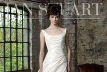 Ian Stuart / Ian Stuart bridal gowns are diverse in styles and shapes and directional within the fashion industry, perfect for those fashion forward brides. Ian's designs are very theatrical and flamboyant, there are many uses of layers, rouching and colours in all of his collections.