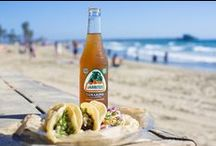 Jarritos by the Beach. / Jarritos, Soft Drink, Mexican Soda, Fruit Flavored Soda, Glass Bottle, Iconic Beverage,  Soda Mixer, , Soda in a Glass Bottle, Real Sugar, Cane Sugar, Made in Mexico, Mexico, Mexican, Natural Flavor Soda, 100 percent natural sugar, Mexican food, cocktail recipes, Mexican, Naturally Flavored, Bright, Colored Soda, Fun Soda, Colorful Sodas, Iconic Mexican Soda.