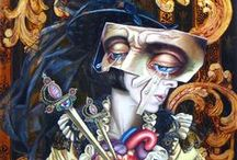Carrie Ann Baade / (born February 18, 1974) is a painter based in Tallahassee. Baade's paintings are oil works blending dense, imaginative contemporary and classic symbology with luminescent color, often featuring themes of mortality, sexuality, personal transformation, and the darker side of human nature. She has been associated with the contemporary surreal movement, though her work treats this in an academic manner that rewards detailed study.