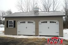 Two Car Garages / These buildings have two garage doors and they're all big enough to fit two cars in them. All buildings were built by Pioneer Pole Buildings. Call 888-448-2505 for any questions.