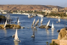 Aswan (www.vantage-travels.com) / Aswan is a beautiful city located in Upper Egypt. It was once the gate to Africa and an important ancient trade center. Aswan today offers beautiful natural scenery in addition to numerous sights of interest. Days can be spent strolling up and down the broad Corniche watching the sailboats etch the sky with their tall masts, or sitting in floating restaurants listening to Nubian music and eating freshly caught fish.