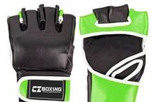 MMA & Boxing Equipment Manufacturer, Suppliers Pakistan / Boxing Equipment: - boxing gloves, gloves, mittens bag, Punching Mitts, Focus Mitts, punching bags, speed balls, head guards, chest guards, groin guards, mouth guards, Boxing wears, boxing Shoes, karate shoes, boxing Shorts, Muay Thai Shorts, shields and hand wraps. MMA Equipment: - Rash Guard & Tank Tops, MMA Shorts & Boxing Shorts, Kick Boxing Trousers, MMA Grappling Gloves, Kick Shields, Karate Mitts, Karate Belts, Bags Foot, key chain, jump ropes, Accessories and Protections Manufacturer.