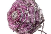 Evening Bags / Evening bags are so pretty. They come in rhinestones or beads, feathers or lace. The only problem is there are not enough events to carry them and show them off.