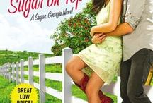 Sugar on Top / Sugar, Georgia series ~ Coming April 2015   ~ The last thing Glory Mann wants is to become chairman of the Miss Peach Pageant in Sugar, Georgia. Spending months hearing nothing but the clinking of pearls and judgment? No thank you! But when Glory is forced to take the rap for a scandal she didn't commit, the judge sentences her to head the committee. Even worse, her co-chairman is rugged, ripped . . . and barely knows she's alive.