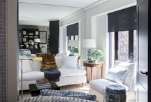 Studio/Suite / Bold walls and white floors. dark and moody, warm textures next to white high gloss lacquer. Blue and white forever. Hidden mirrors to maximize visual space and light behind white shutters.