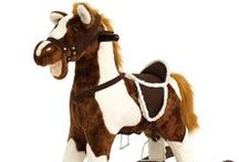 """Rocking Horses / Rockin' Rider Rocking Horses feature soft plush over a lightweight and sturdy foam core.  They sing the """"I'm a Little Pony"""" song and sit on top of beautiful hand-carved wooden rocking bases."""