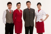 Flight Attendant Uniforms / Our flight attendants model the uniforms of Cathay Pacific since 1946.