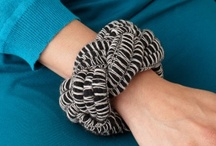 i love yarn: bracelets & bangles / Stacked bracelets are a fashion trend that's not fading fast. But if you're worried about metal bracelets clacking together, try layering yarn bracelets. Here are our favorite DIY ideas for yarn bracelets, yarn cuffs, and yarn bangles. Some yarn bracelets involve knitting and crocheting, others use braiding, macrame, or yarn-wrapping techniques. These make great last-minute holiday gifts and would be fun to make in a group for a girl's night out, birthday party, or bridal shower craft. / by I Love Yarn Day