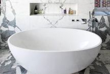 BATHROOMS / Dream bathroom interiors and finishes. Free standing bath tubs, stainless steel showers and marble flooring.
