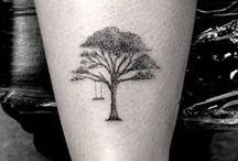 Tattoos / by Kayla Bilderback