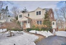 Tenafly SOLD | $885,000 / A CLASSIC CENTER HALL COLONIAL ON TENAFLY'S EAST HILL A FIVE MINUTE WALK FROM MAUGHAM SCHOOL. ALL HARDWOOD FLOORS, LARGE BEDROOMS, LAUNDRY ON SECOND FLOOR LIVING ROOM WITH A WOOD BURNING FIREPLACE, UPDATED KITCHEN WITH GRANITE COUNTERS AND STAINLESS STEEL APPLIANCES, LARGE DINING ROOM AND AN AMAZING SUN ROOM OVERLOOKING THE LARGE PROPERTY.