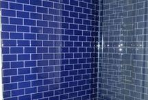 Bathroom Renovations in Mt. Lebanon, PA / A old bathroom gets a modern renovation update with a beautiful walk in shower with cobalt blue glass tile, carrara marble countertop, soaking tub and sliding privacy barn door.