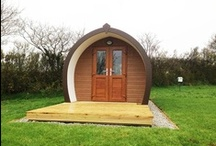 Camping Pods / 'Glamping' in Cornwall in the Meadow Lakes camping pods providing convenient, comfortable and alternative overnight accommodation, similar to camping but without the drawbacks of weather conditions. These custom-built,  sleeping pods are located close to our four well stocked coarse fishing lakes. The pods are constructed of sustainable timber and are very well insulated, keeping you warm in the winter and cool in the summer. The Pods also have heating, electrical points and lighting.