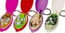 Pocket critters / Keychain pods that hide a cute and lovely animated scene.  Each time you close the pod, the toy gets automatically wound up so that when you click the pod back open anew, the toy moves.