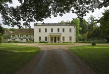 Georgian Grandeur / A Chiltern estate with an elegant tree-lined drive, pleached limes framing the house and a generous terrace overlooking a lawn, pond and ha-ha to pastures beyond